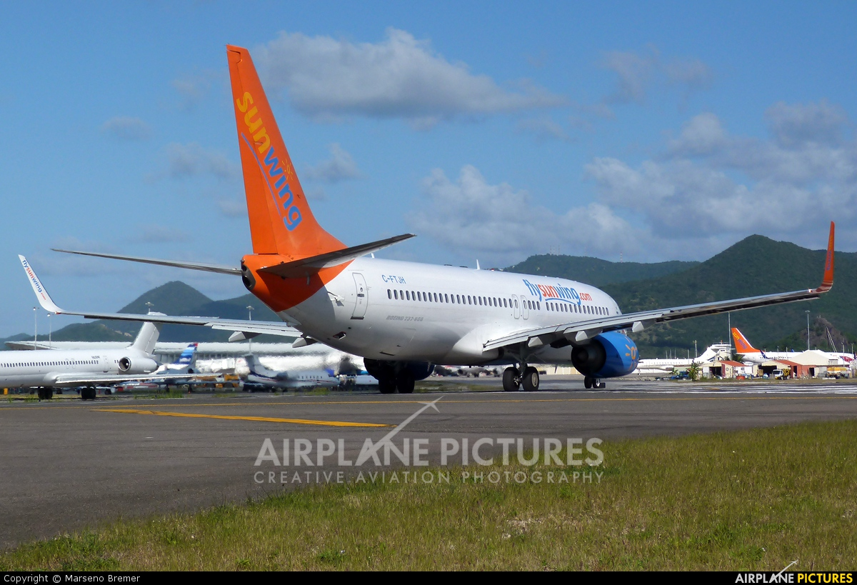 Sunwing Airlines C-FTJH aircraft at Sint Maarten - Princess Juliana Intl