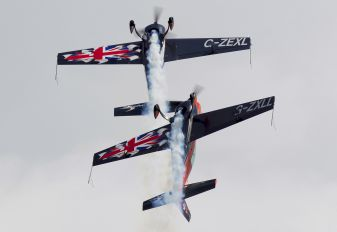 "G-ZXLL - 2 Excel Aviation ""The Blades Aerobatic Team"" Extra 300L, LC, LP series"