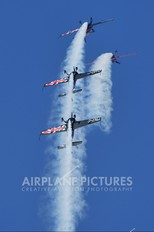 """G-ZXLL - 2 Excel Aviation """"The Blades Aerobatic Team"""" Extra 300L, LC, LP series"""