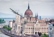 """The Flying Bulls"" B-25 front of the hungarian Parliament title="