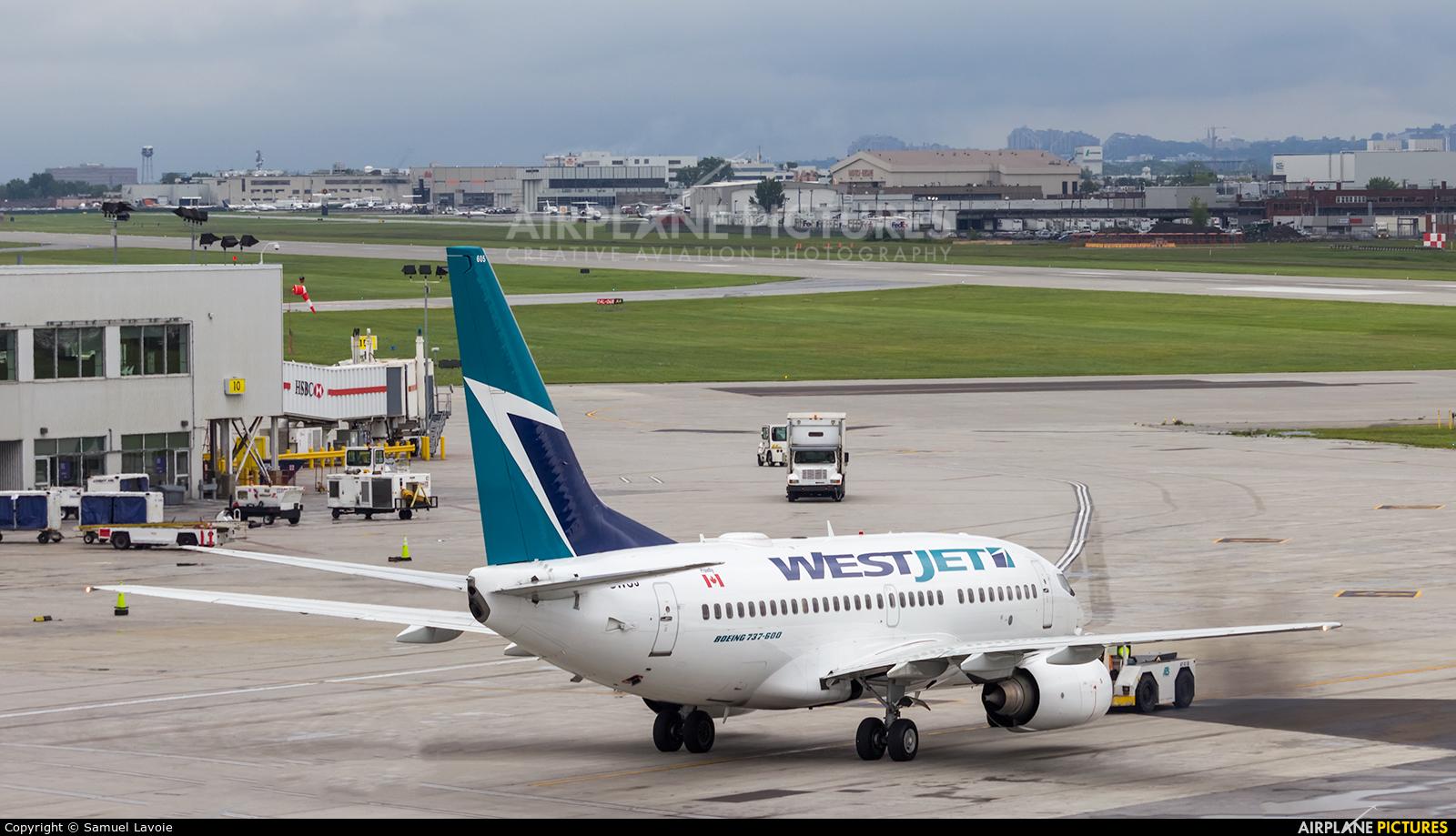 WestJet Airlines C-GWSJ aircraft at Montreal - Pierre Elliott Trudeau Intl, QC
