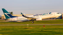 First WestJet 737-800 wearing the new logo title=