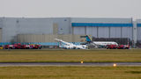 Flybe Dash 8 gear collapsed on landing at AMS