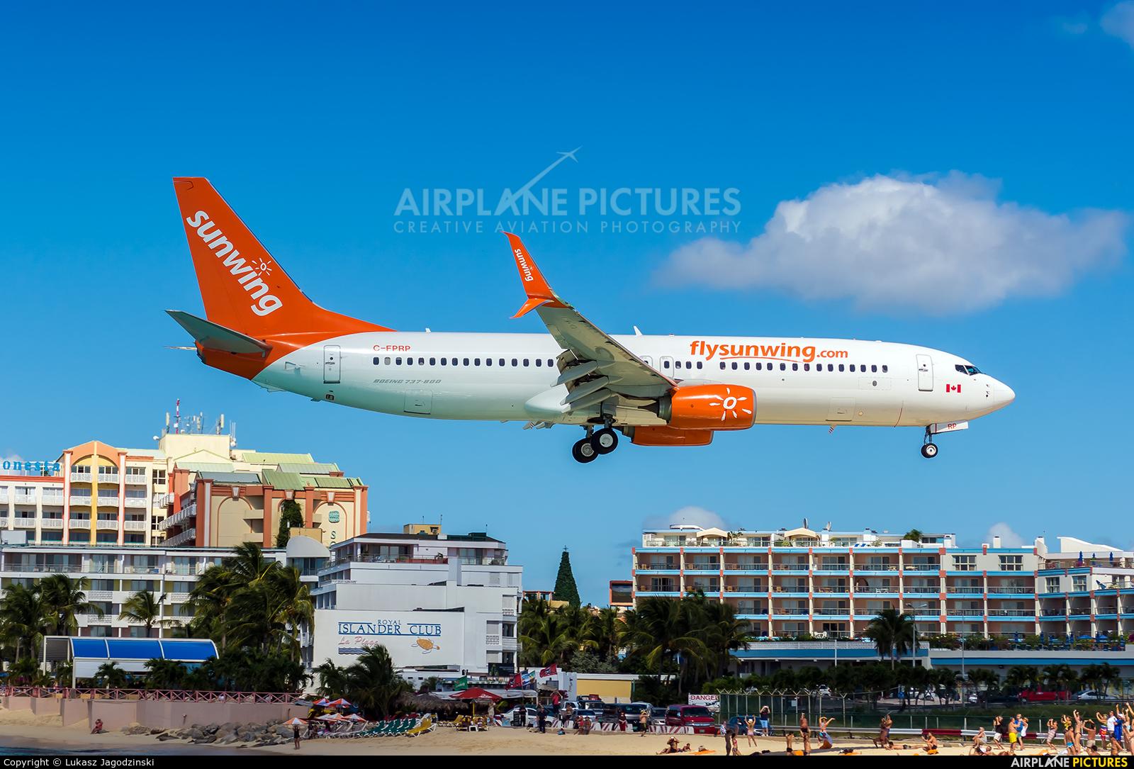 Sunwing Airlines C-FPRP aircraft at Sint Maarten - Princess Juliana Intl
