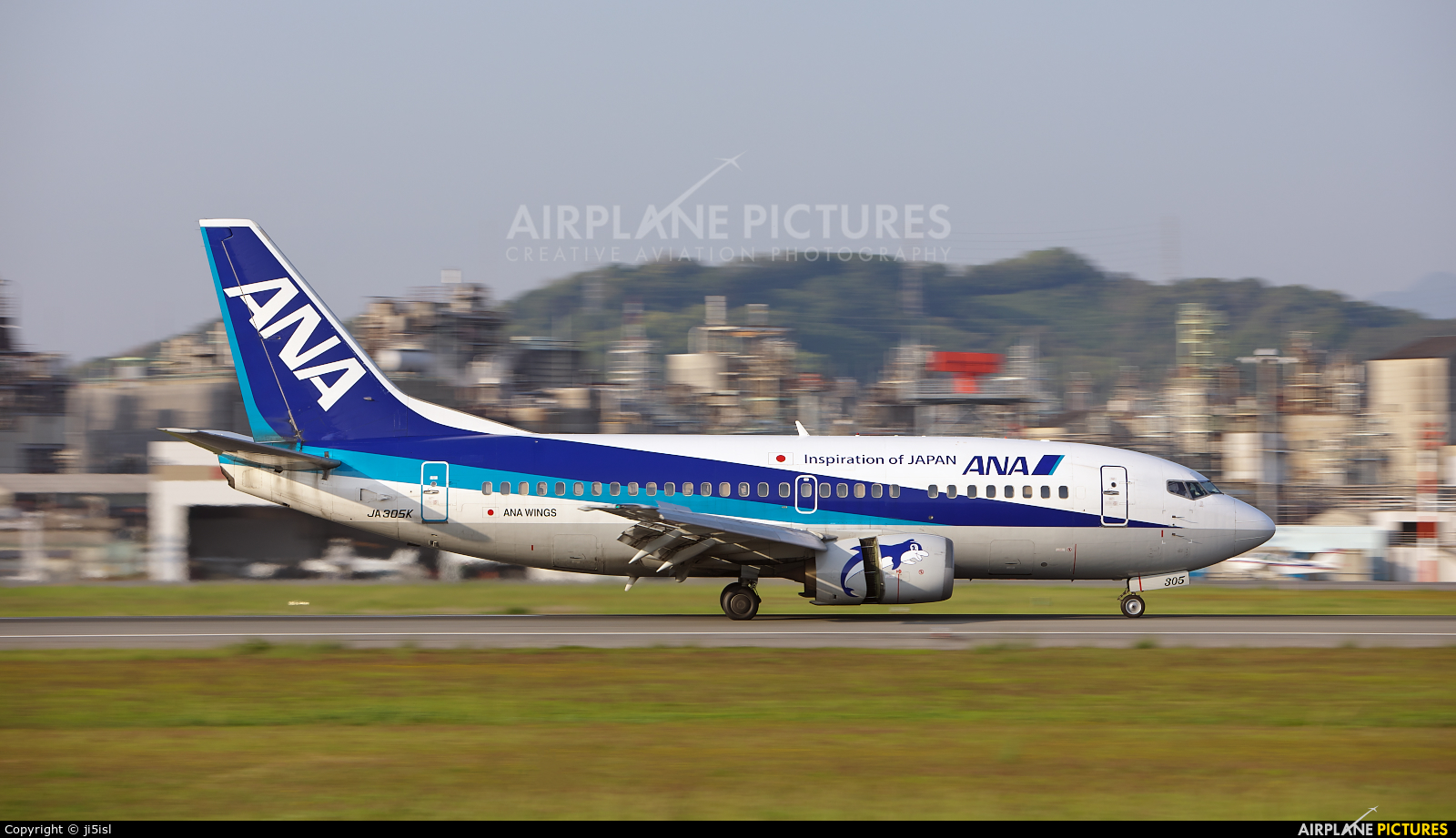 ANA Wings JA305K aircraft at Matsuyama