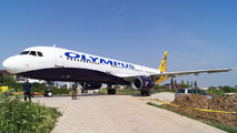 Ex-Monarch A321 now wears hybrid Olympus Airways livery title=