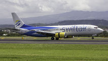 Rare visit of SwiftAir B734 to San Jose title=