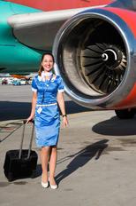 UR-WRH - Windrose Air - Aviation Glamour - Flight Attendant