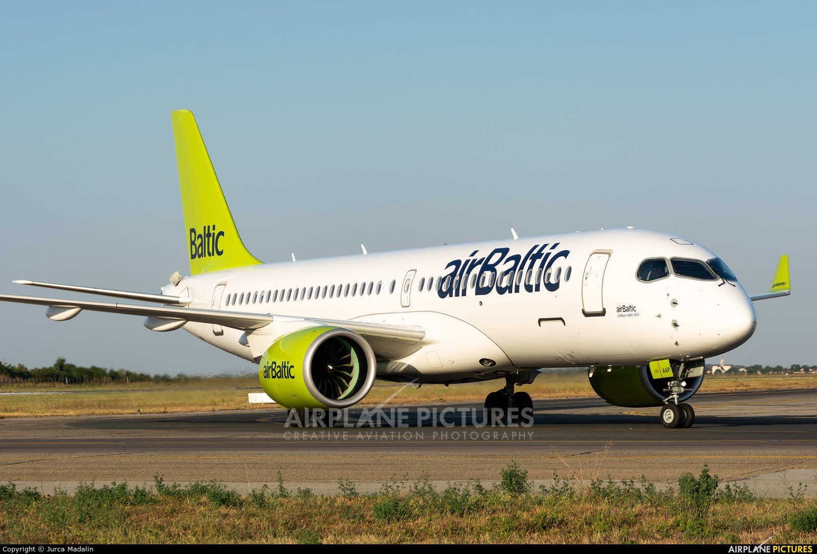 Air Baltic YL-AAP aircraft at Bucharest - Henri Coandă