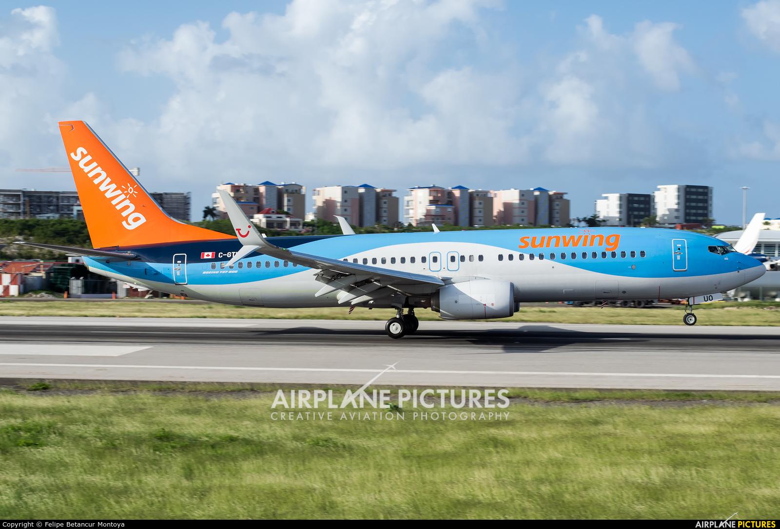 Sunwing Airlines C-GTUO aircraft at Sint Maarten - Princess Juliana Intl