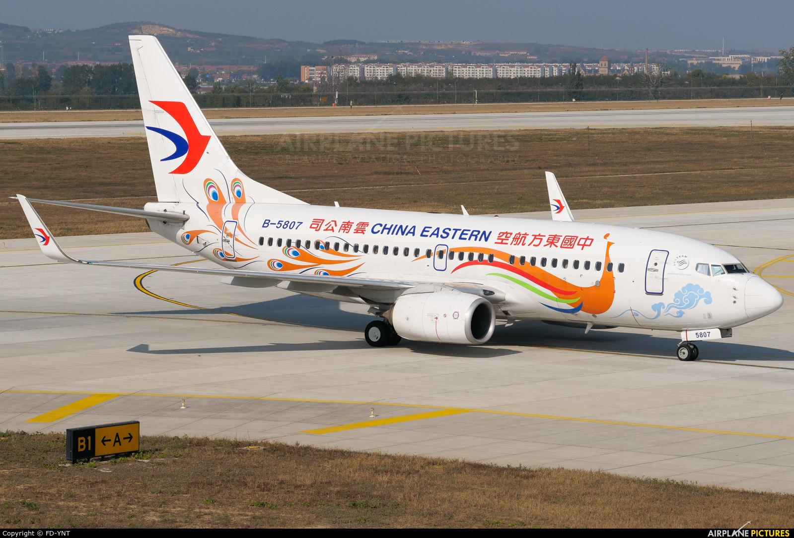 China Eastern Airlines B-5807 aircraft at Yantai Penglai Intl