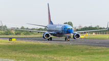 Very rare visit of Sun Country Boeing 737 to Poznań title=